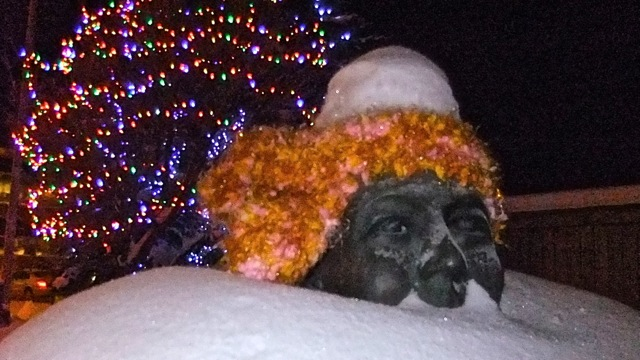 Have mercy on Robert Service, he can hardly see the lights around him because of the snow that is piling up!