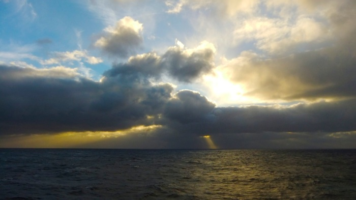 Beautiful sunset with a rough sea. North of the Azores Islands.
