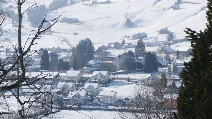 """Located on a sunny hill in the middle of a rural town in the Entlebuch valley: """"Haus der Gastfreundschaft"""" - The Hospitality House. - Auf einem sonnigen Hügel, eingebettet ins ländliche Dorf im Entlebuch: Das Haus der Gastfreundschaft."""