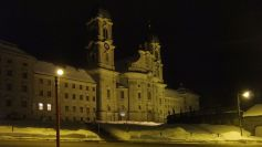 The abbey of Einsiedeln is both a gathering point for pilgrims on the Way of St. James and a destination for many pilgrims who seek guidance from the black madonna. - Einsiedeln ist sowohl ein Treffpunkt für viele Jakobspilger als auch ein Wallfahrtsort, an den Leute den Beistand der schwarzen Madonna suchen.